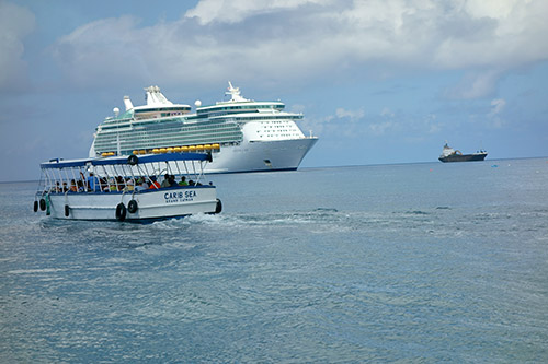 Royal Caribbean's Navigator of the Seas and a ferry boat carrying passengers at this tender port on our Caribbean Cruise vacation